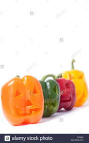 halloween faces carved into capsicum bell pepper vegetables