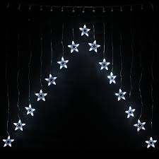 christmas curtain lights stars decorate the house with beautiful