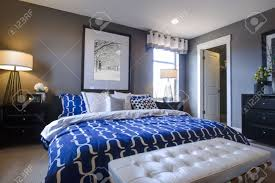 Modern Master Bedroom Images Modern Master Bedroom With Blue Wall And White Linens Stock Photo