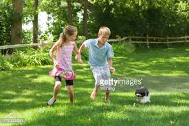 In Backyard Children Playing Together In Backyard Stock Photo Getty Images
