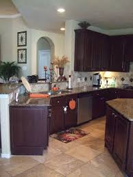 gray walls with stained kitchen cabinets tired of your kitchen s stale espresso colored cabinets do