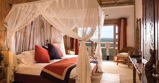 bedroom african bedroom with high comfort bed feat brown