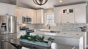 white kitchen cabinets with river white granite cambridge white river run