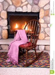 wood rocking chair in front of home fireplace royalty free stock