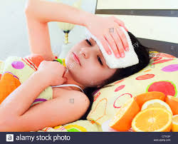 Girls In Bed by Sick In Bed With Fever Stock Photo Royalty Free Image