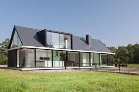 Modern House Roof Design Modern Barn Style Home Showcases Glazings And Below Grade Ramp