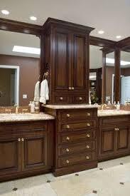 Dual Vanity Bathroom by The Master Bathroom Has Black Granite Countertops With Double