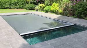aquamatic swimming pool safety cover with hidden leading edge bar