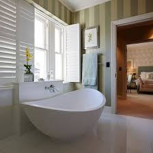 again luxury free standing bath with plantation shutters for - On Suite Bathroom Ideas
