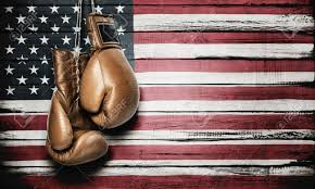 American Flag Wall Hanging Boxing Gloves Hanging On Wooden Wall With American Flag Stock