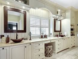 bathroom bathtub double sinks frosted glass cabinets towels