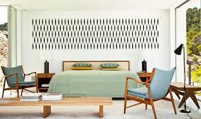 white wooden bookshelves round dining table mid century modern