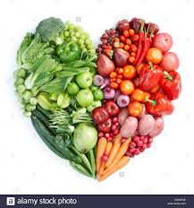 types of red colors heart shape form by various types of vegetables and fruits in