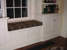 great looking bay window seat design with twin white bookshelves