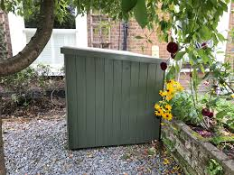 a subtle green paint colour on this bike shed fitted in chiswick