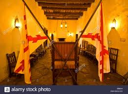spanish governors palace spanish flags dining room leather chairs