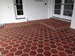 backyard patio with hexagonal tiles cleaning your outdoor tiles