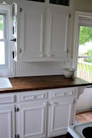 add trim to flat panel kitchen cabinets to remake old