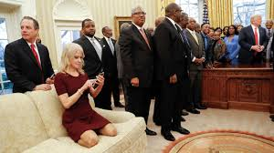 photos of white house adviser kellyanne conway kneeling on oval