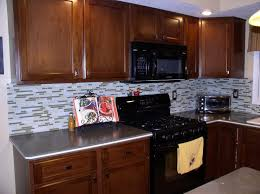 Pepper Shaker Cabinets Kitchen Wall Tiles Ideas Black Granite Cou Wooden Tables And