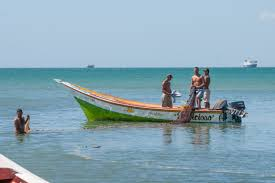 file fishermen returning from fishing in el guamache margarita