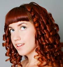 sissy hairstyles woman with shoulder length red curly hair similar to a rag curl