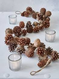 how to make a pinecone garland pinecone pine cone and twine