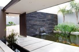 Interior Waterfall Design by Architecture Indoor Fish Pond Waterfall Bamboo Plants Stone Wall