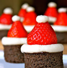 top round brownie bites with strawberry santa hats christmas