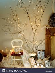 home made tree of lights on branches above