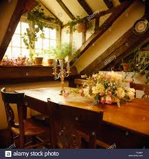 floral arrangement on dining table in eighties loft apartment in