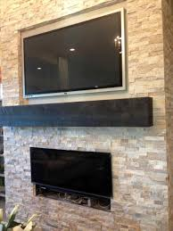 fireplace refacing faux stone panels living room with tuscan