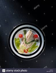 elegant dinner plate fish filet pea pods tomato tomatoes garnish