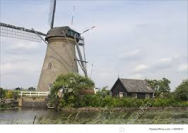picture of dutch windmill and shed