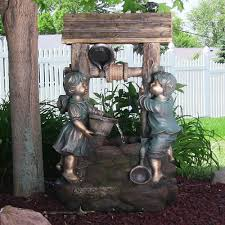 boy and wishing well lighted outdoor water