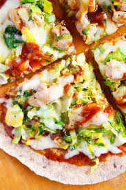 California Pizza Kitchen Tostada Pizza Sriracha Bbq Chicken Leek And Brussels Sprouts Pizza Table For