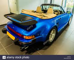 blue porsche 911 porsche 911 turbo cabriolet flatnose blue rear 3 4 view stock