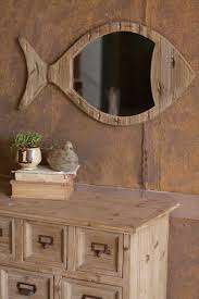 rustic wooden fish mirror at seasideinspired home