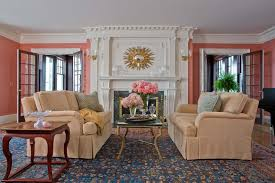 coral wall color design with decorative white fireplace for small