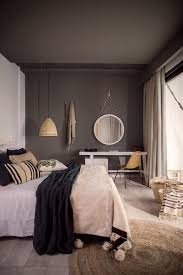 this is a great way to make grey feel really warm in a bedroom