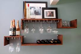 items similar to wall mounted wine rack and glass candle or book