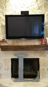 hung a tv on rock fireplace and created a media closet texags