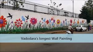 vadodara s longest wall painting outside railway station wall with vadodara s longest wall painting outside railway station wall with msg of conserving growing trees
