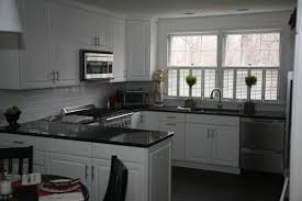 grey kitchen cupboards with black worktop black granite countertops styles tips infographic