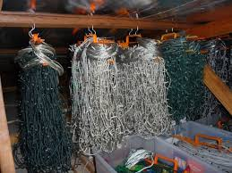 how to store christmas lights staggering storing christmas lights on hangers in attic without