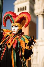 venetian jester costume a woman in a jester s costume peeks out from a column