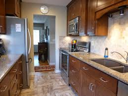 Before And After Galley Kitchen Remodels Renewing This House The Kitchen Before And After