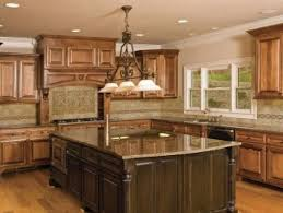 brown wooden kitchen cabinet and mocha backsplash connected by