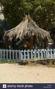 a beach house with a gazebo palm roof on the beach at thousand