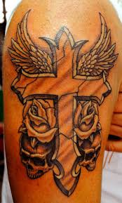 fabulous cross wings with beautiful flowers and skulls tattoo on